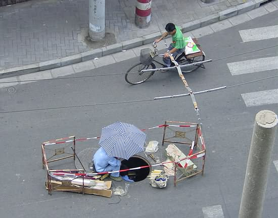 China Telecom Workers under the Umbrella