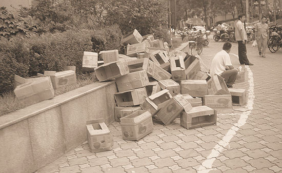 Boxes Scattered on the Sidewalk